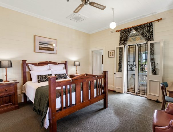 Deluxe room opening onto balcony Queen bed with room for child on trundle